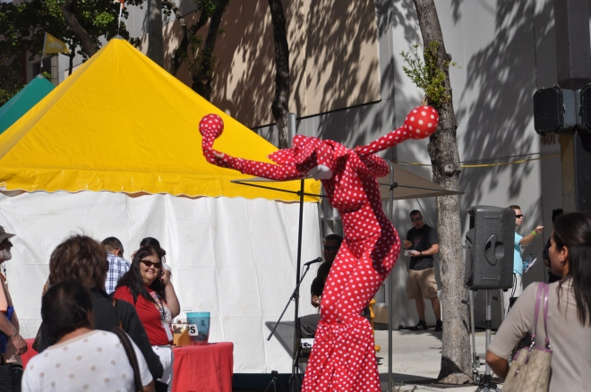 A stilt walker entertains visitors at the 2012 Miami Book Fair.