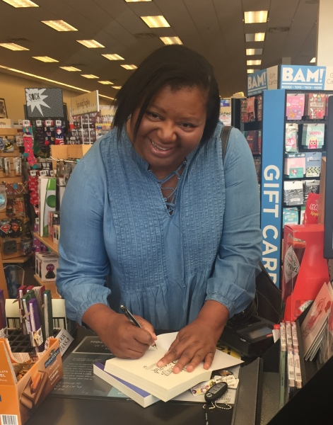 Signing copies of my book at store.